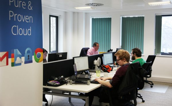 Ancoris staff working in the office