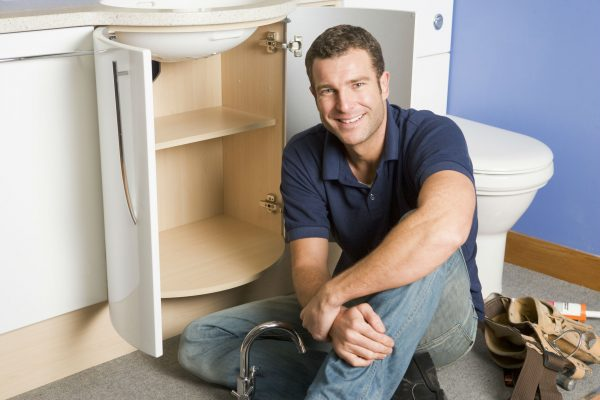 Plumber-on-site-doing-repair-600x400