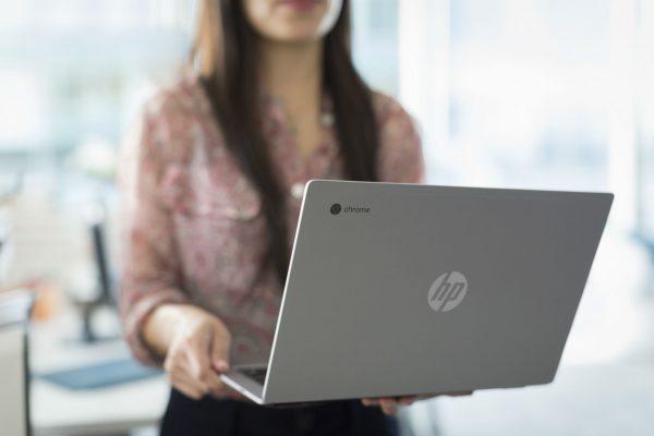 Woman-holding-Chromebook-600x400