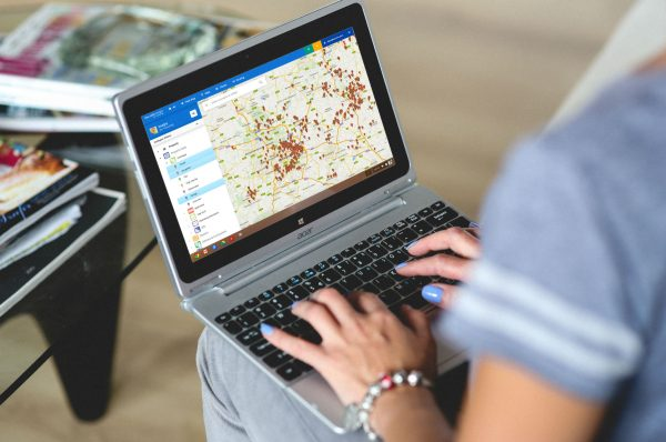 Woman using Ancoris Maps for Housing on laptop