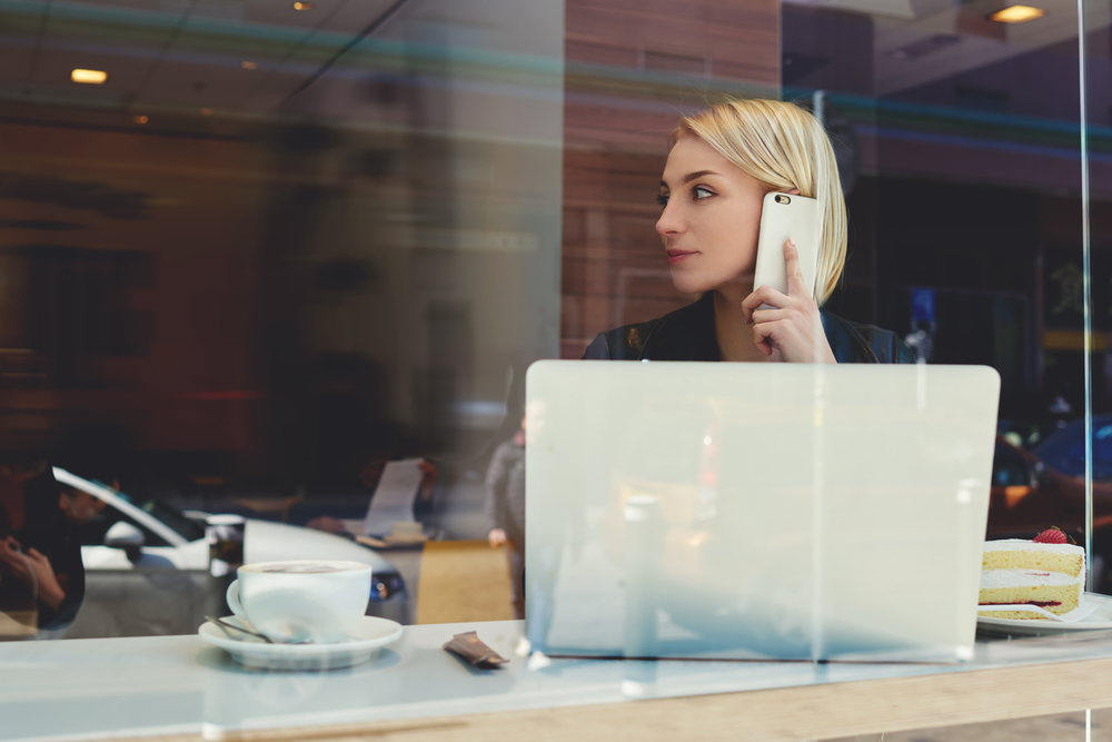 Woman on phone using Google Voice