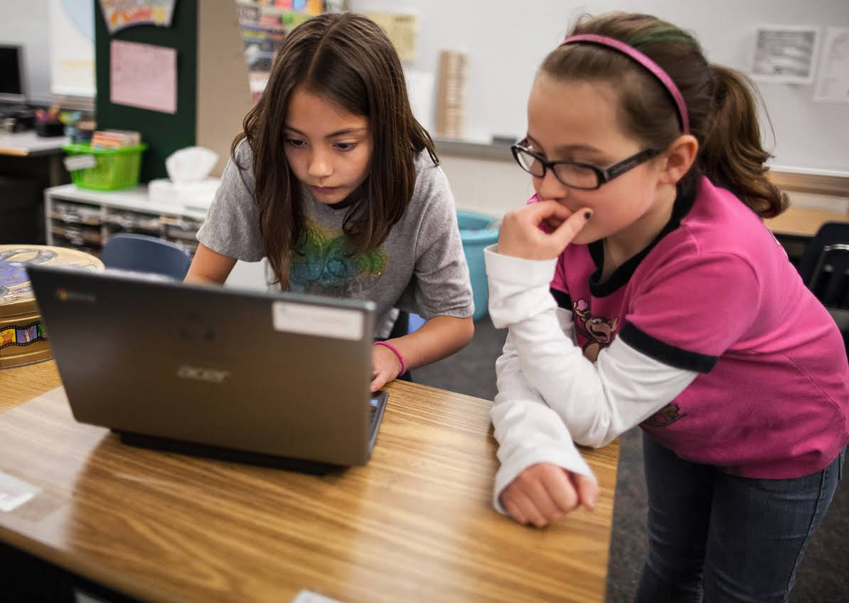 google-education-girls-devices